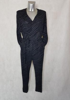 e2fffbe6d4e4f Combi-pantalon femme noir à motif et paillette coupe fuselée col V effet  cache coeur